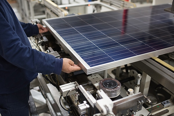 production of solar panels, man working in factory