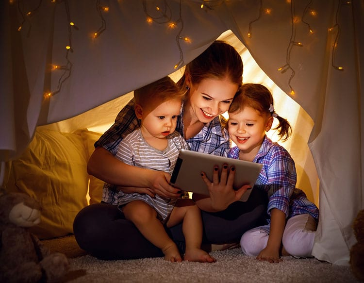 Mother and daughters watching tablet