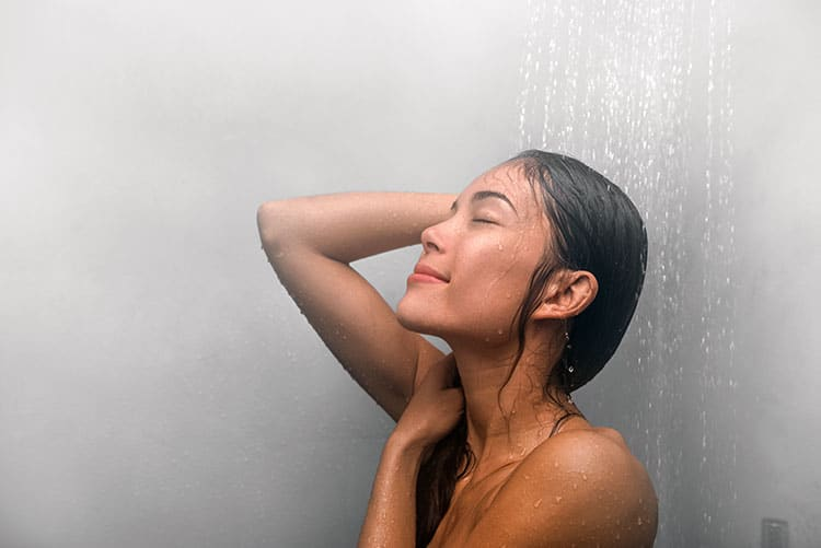 Woman in shower with free hot water